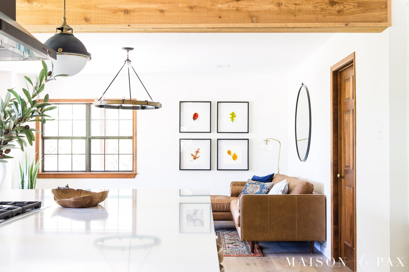 open kitchen living with simple botanical wall art   Maison de Pax