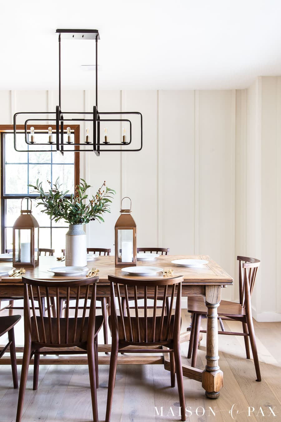 white dining room with board and batten wood wall treatment