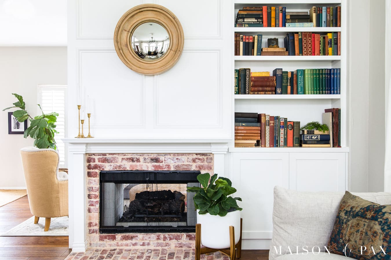 brick fireplace with white molding and built in bookcase | Maison de Pax