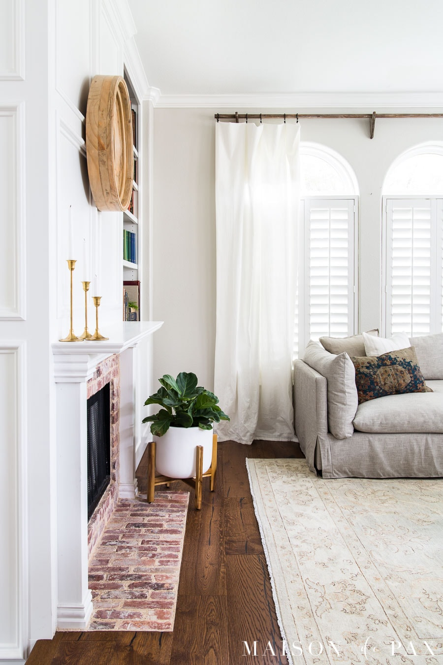 decorate a neutral space with texture: brick, area rugs, wood, linen   Maison de Pax