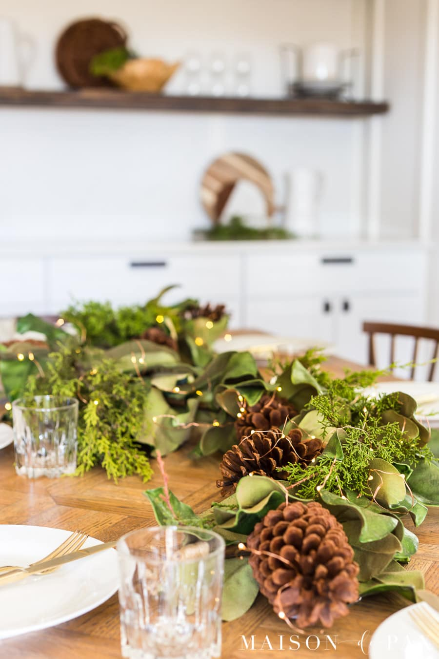 magnolia leaves, pinecones, and cedar centerpiece | Maison de Pax