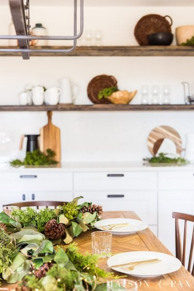 simple holiday table with magnolia leaves and fresh cedar | Maison de Pax