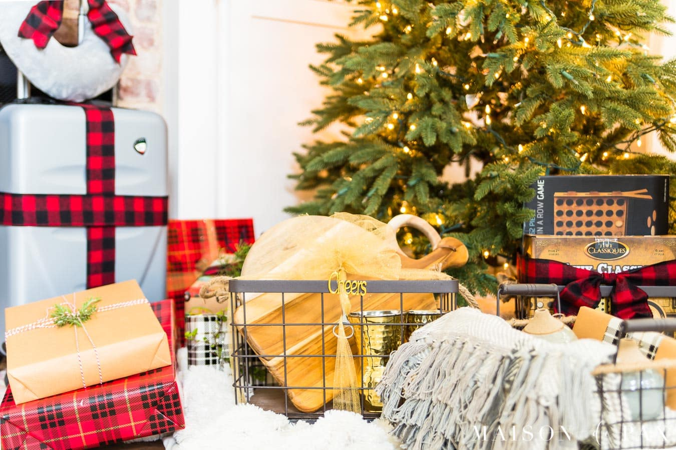 gift baskets and presents wrapped under Christmas tree | Maison de Pax