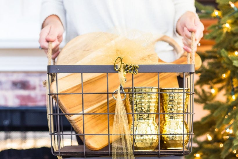 woman holding gift basket with entertaining gifts | Maison de Pax