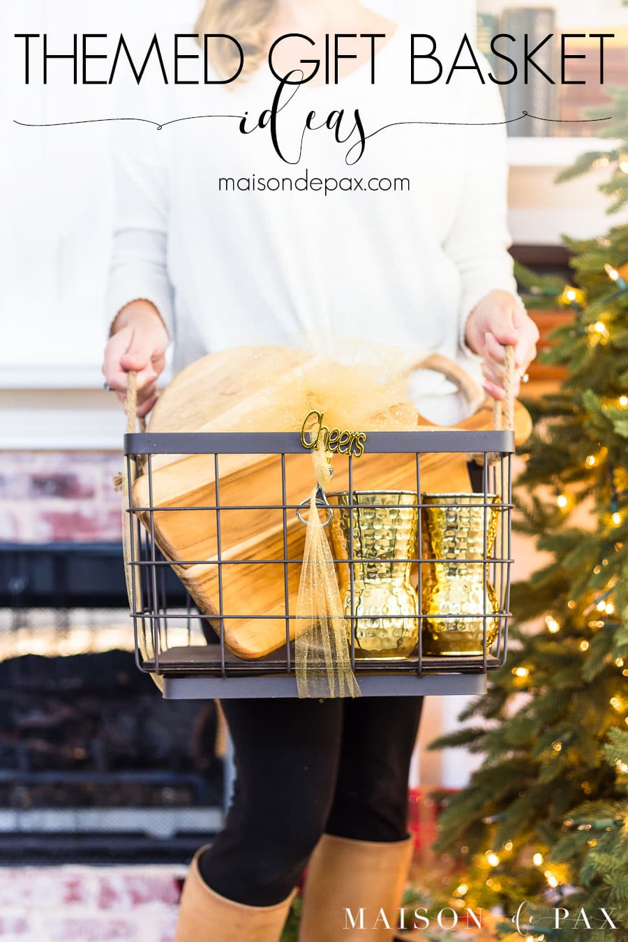 woman holding basket in front of tree with overlay: themed gift basket ideas | Maison de Pax