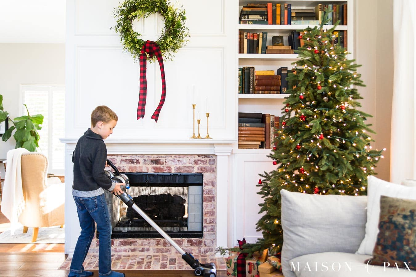 boy using Hoover ONEPWR Blade to vacuum needles under Christmas tree | Maison de Pax