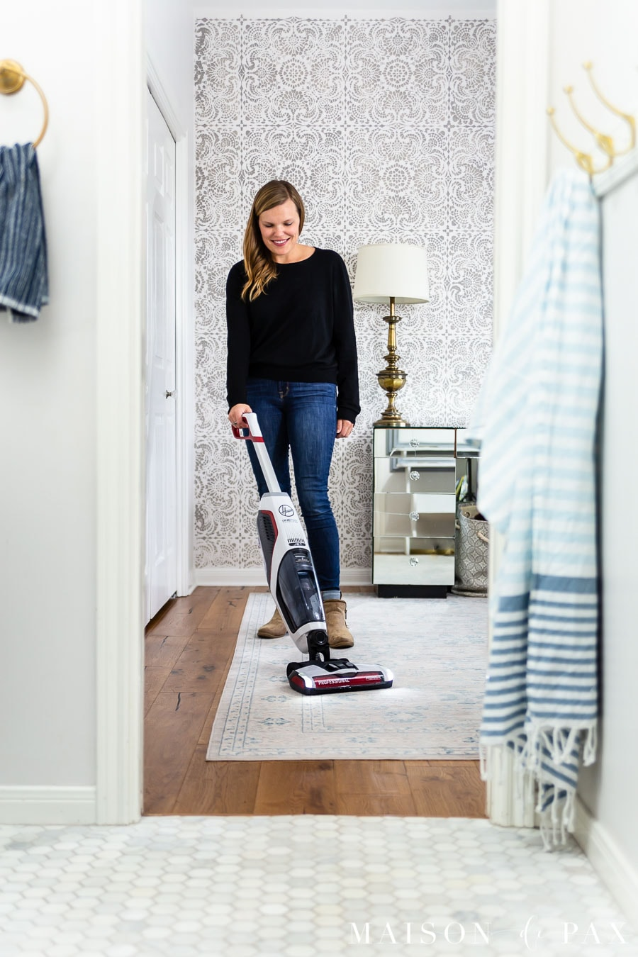 woman vacuuming rug with Hoover ONEPWR Floormate Jet | Maison de Pax