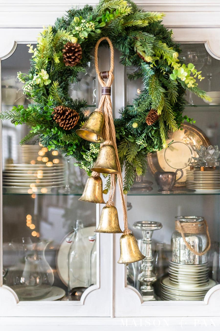 gold jingle bells on mixed green holiday wreath | maison de pax