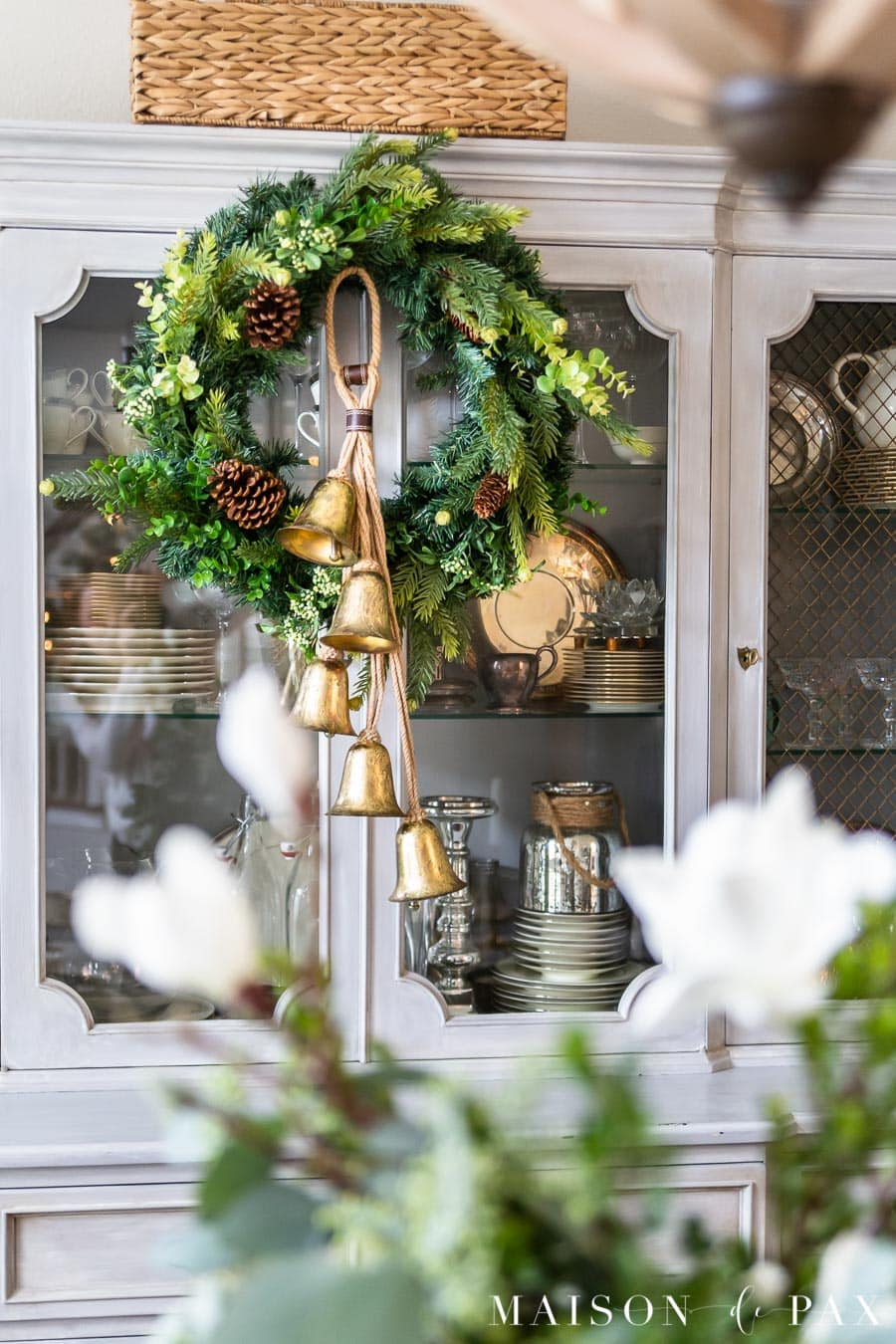 green wreath with gold bells