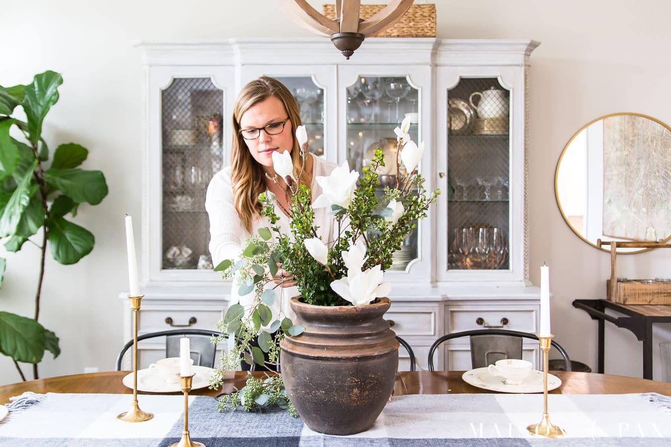 woman arranging holiday centerpiece | Maison de Pax