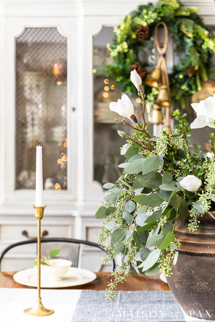 green and white holiday centerpiece in black pot | Maison de Pax