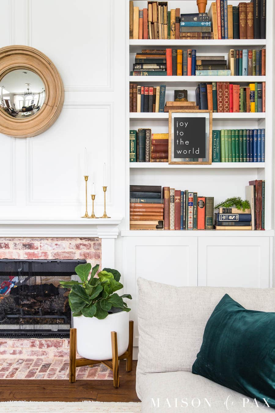 bookcase with antique books and fiddle leaf fid | Maison de Pax