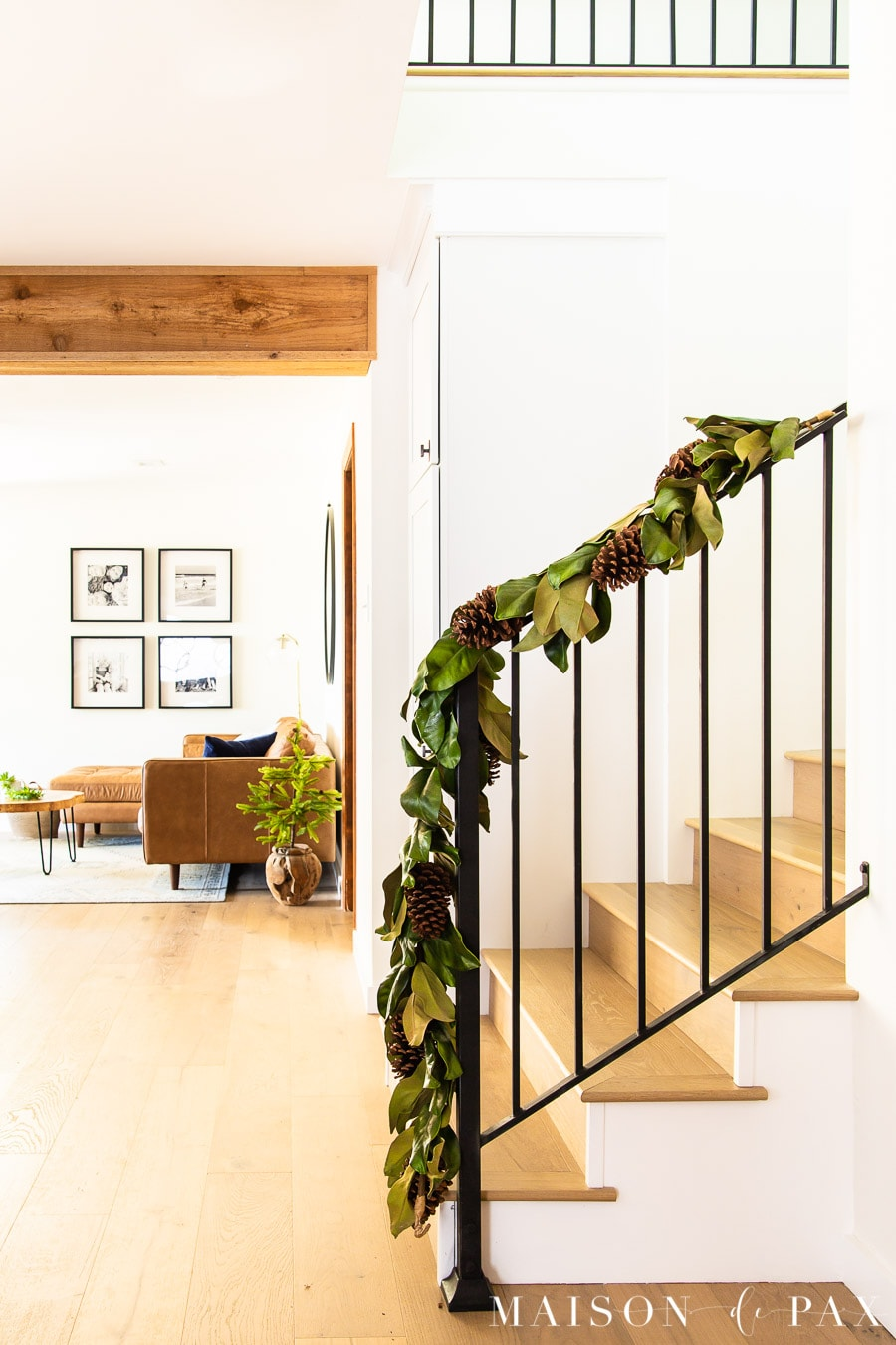 black metal banister with magnolia leaf garland | Maison de Pax