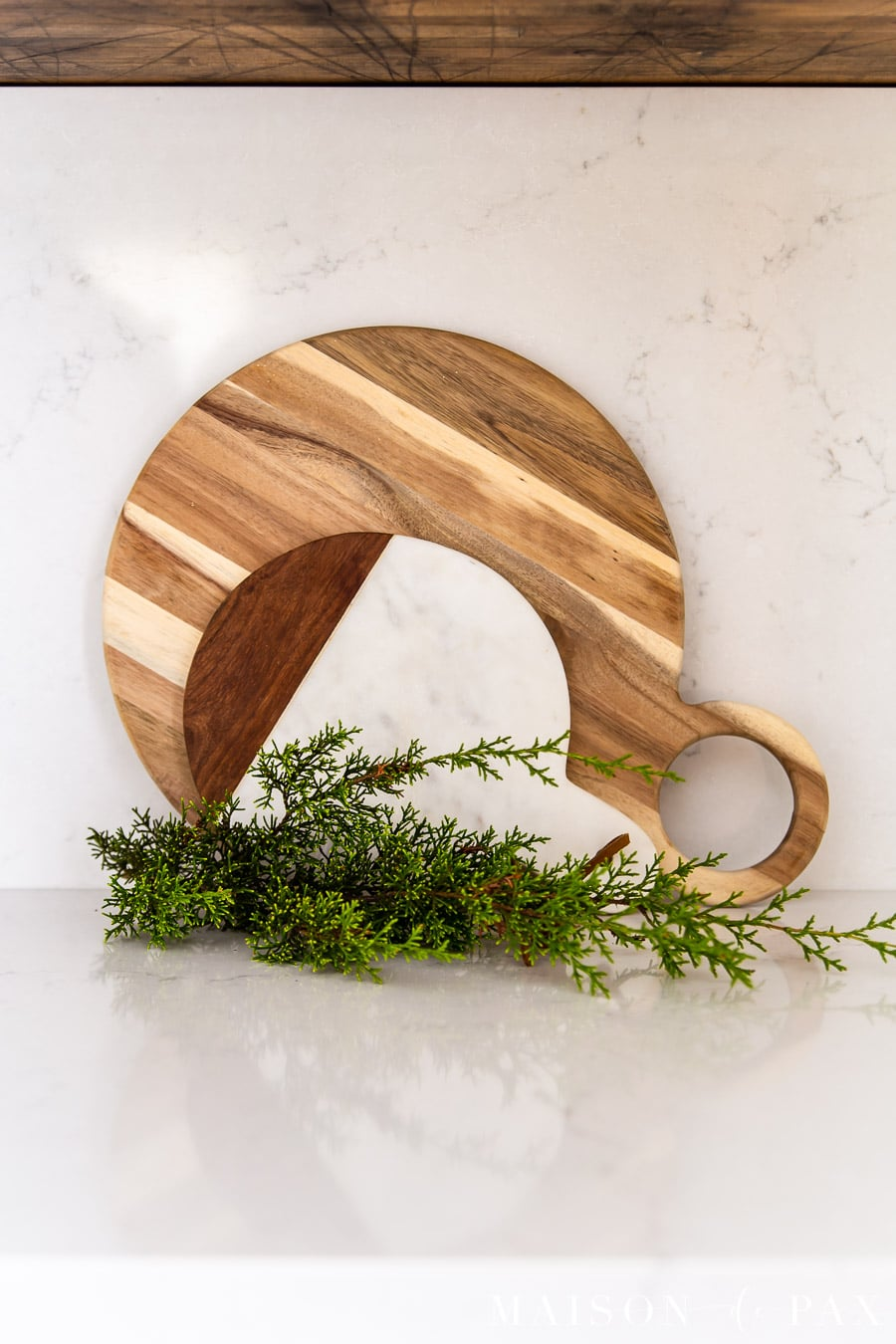 marble and wood cutting boards with cedar clippings on quartz counters | Maison de Pax