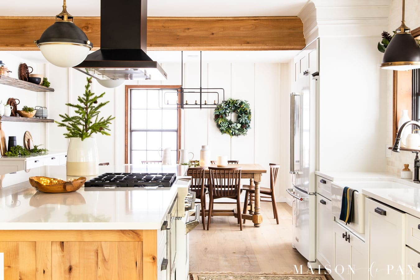 white and wood kitchen with holiday greenery | Maison de Pax