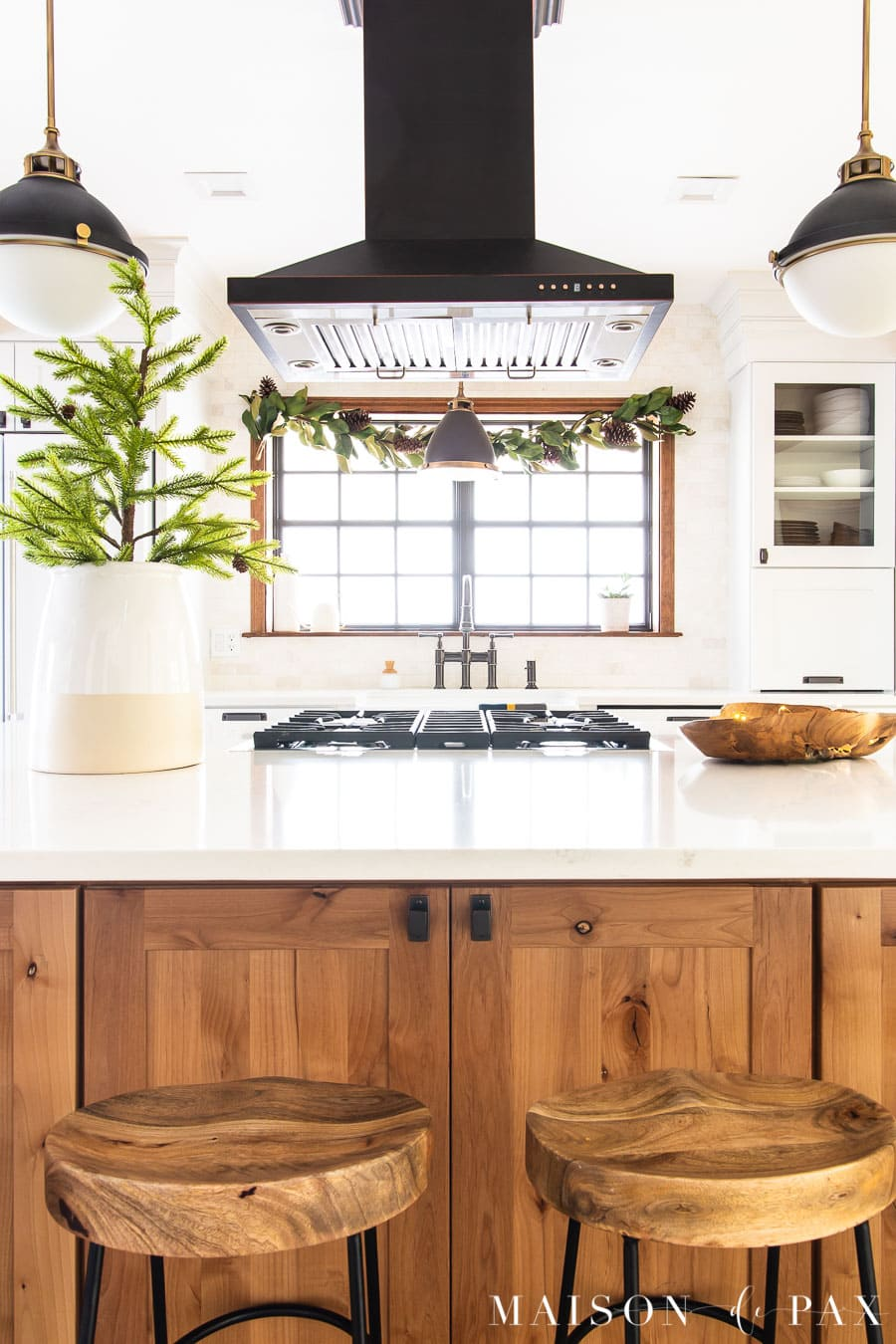 big island kitchen with magnolia garland | Maison de Pax