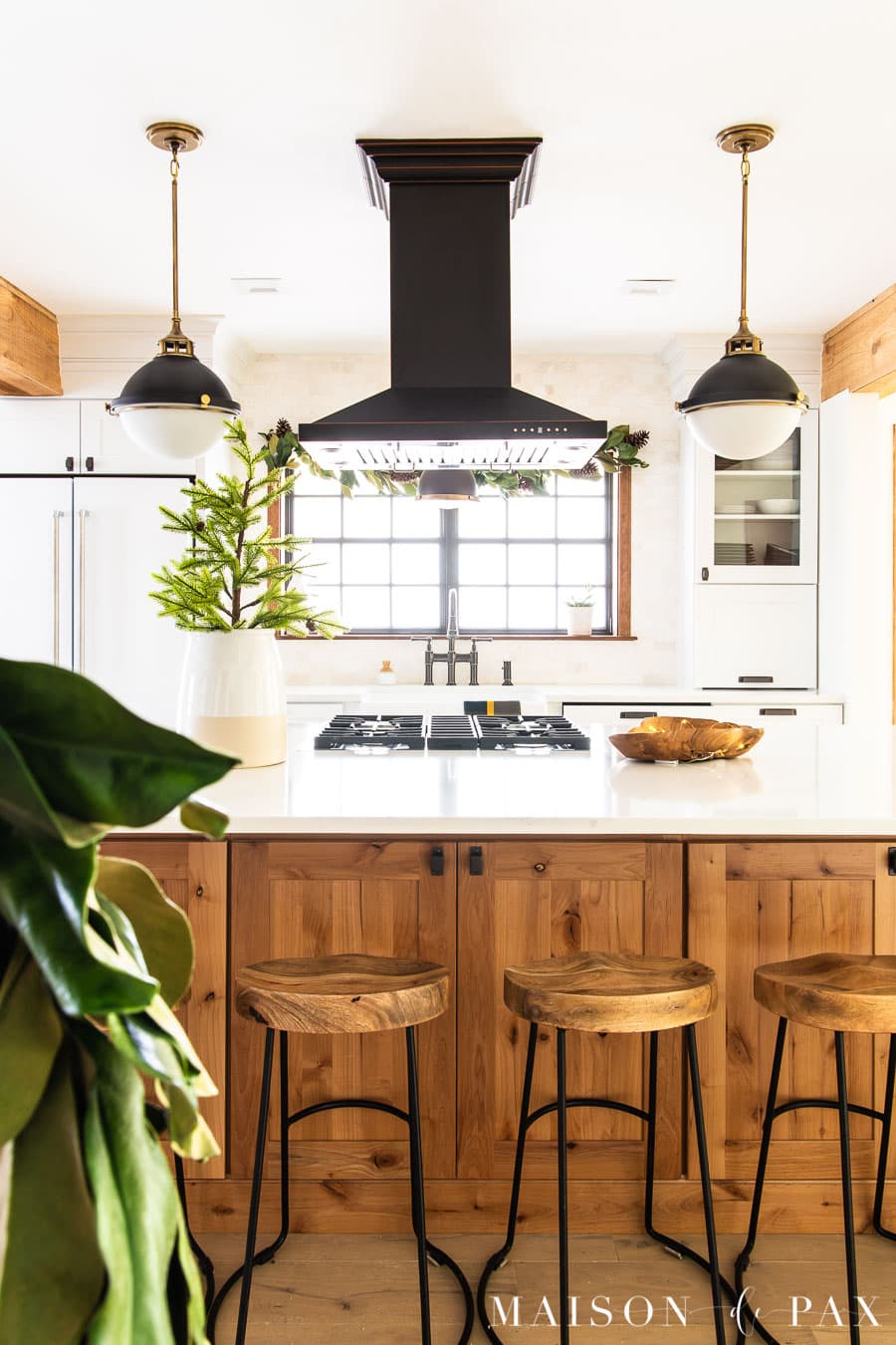 island with hood and black and white pendant lights | Maison de Pax