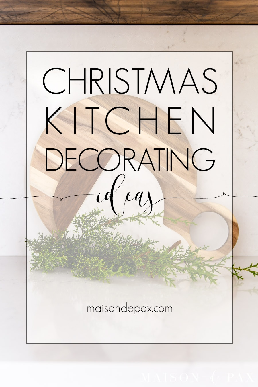 cutting boards with fresh holiday greenery | Maison de Pax