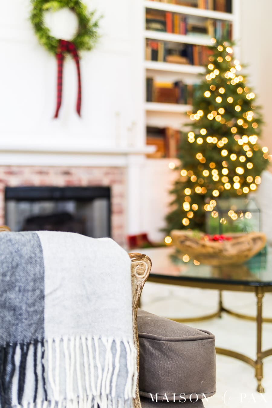black and white wool plaid throw over arm of gray chair in christmas living room | Maison de Pax