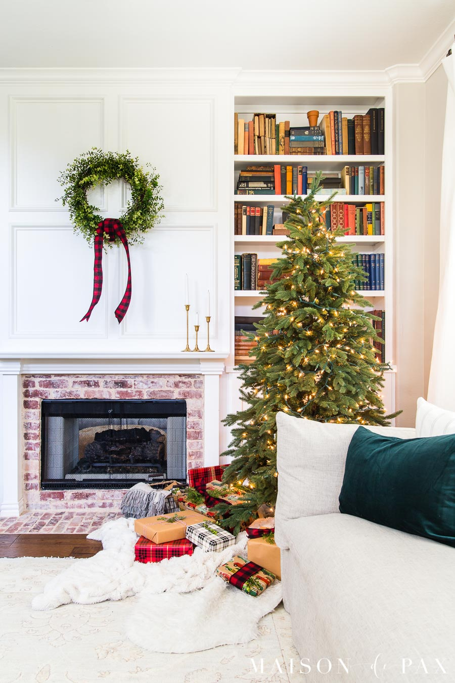 white mantel with simple green wreath and naked tree and red buffalo plaid | Maison de Pax
