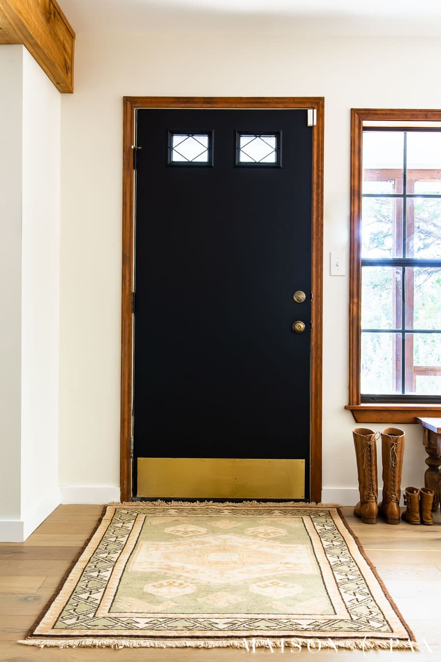 entry way with black door and vintage rug and security door sensor | Maison de Pax