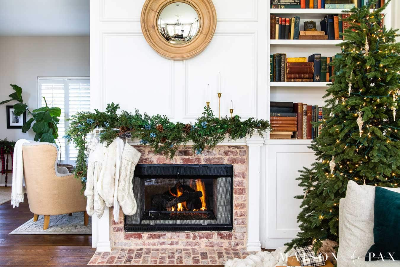 fireplace with greenery and naked tree | maison de pax