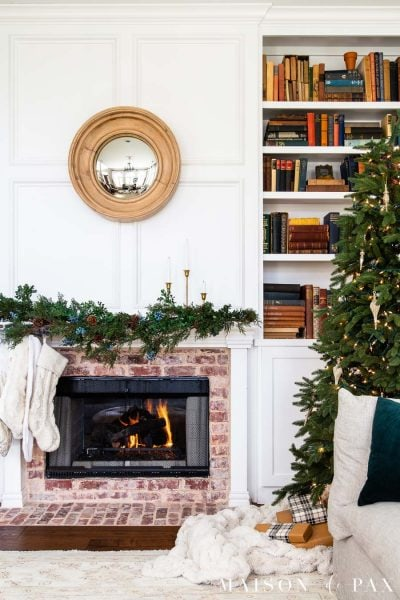 naked tree and simple garland with brick fireplace | Maison de Pax