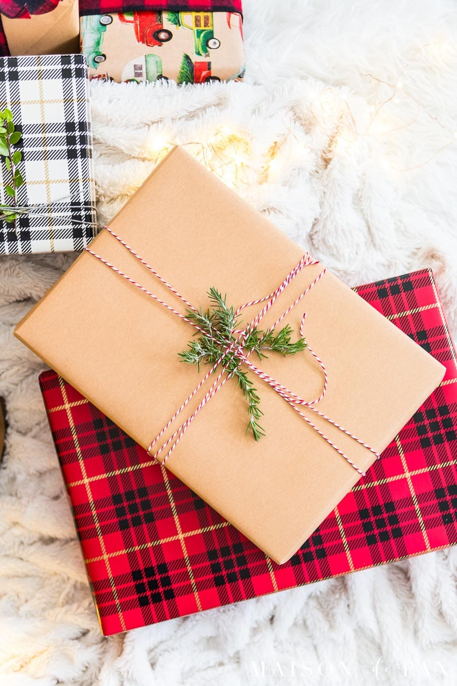 red and black plaid and brown paper packages | Maison de Pax