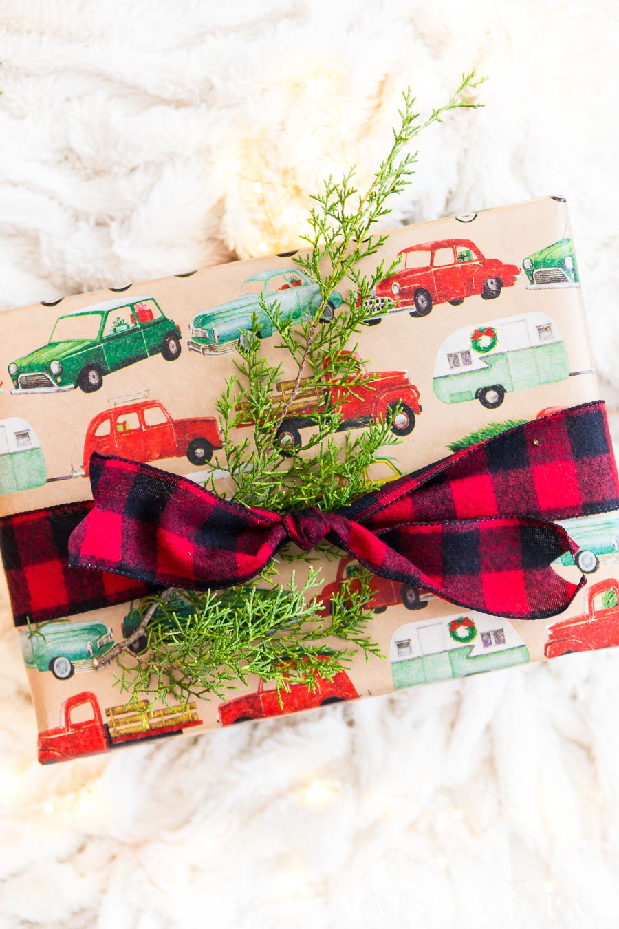 christmas present with cedar clipping and red plaid ribbon | Maison de Pax