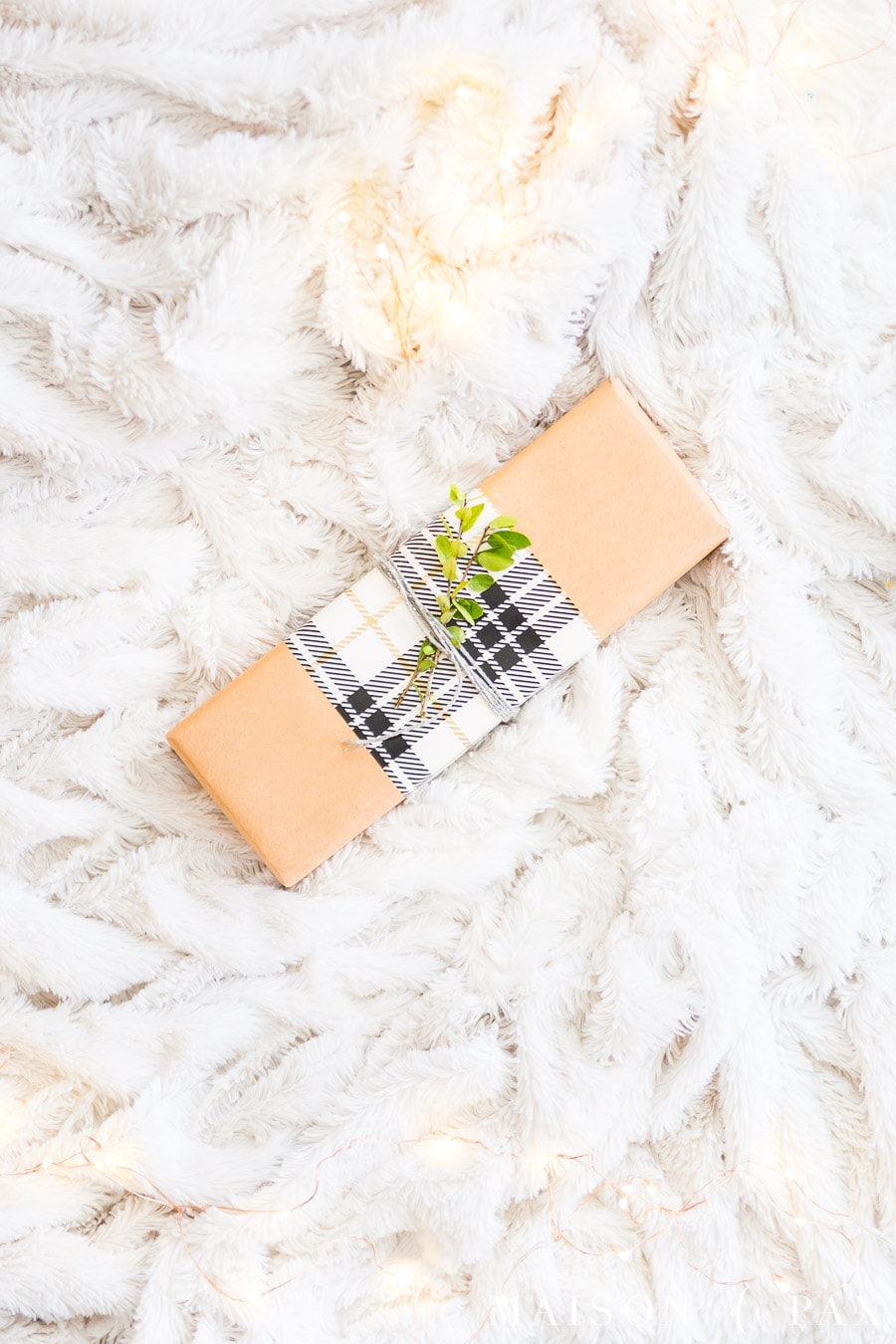 brown paper package with white plaid ribbon | Maison de Pax