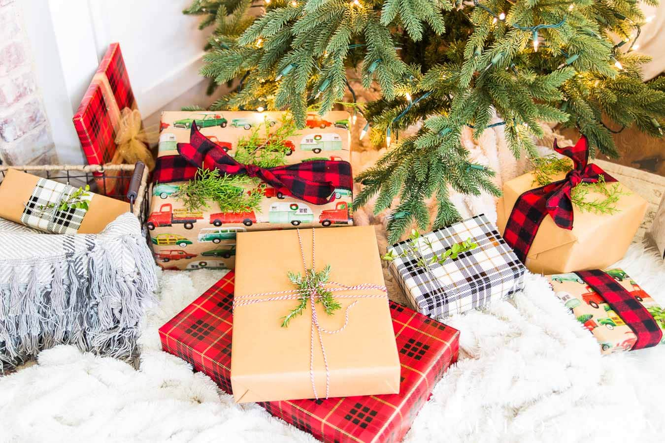 christmas presents under tree with brown paper and plaid wrapping paper | Maison de Pax