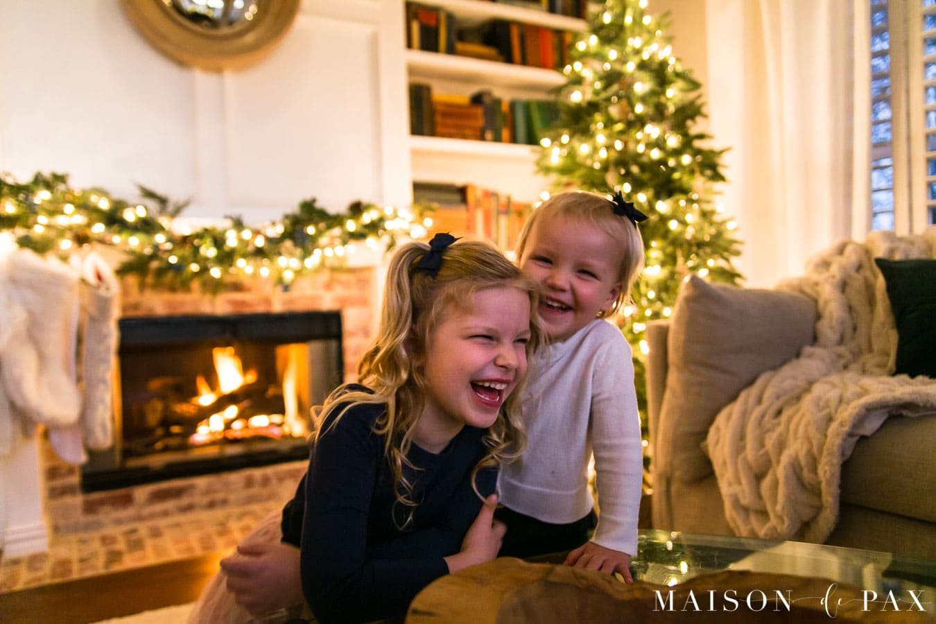 girls laughing by christmas tree | Maison de Pax