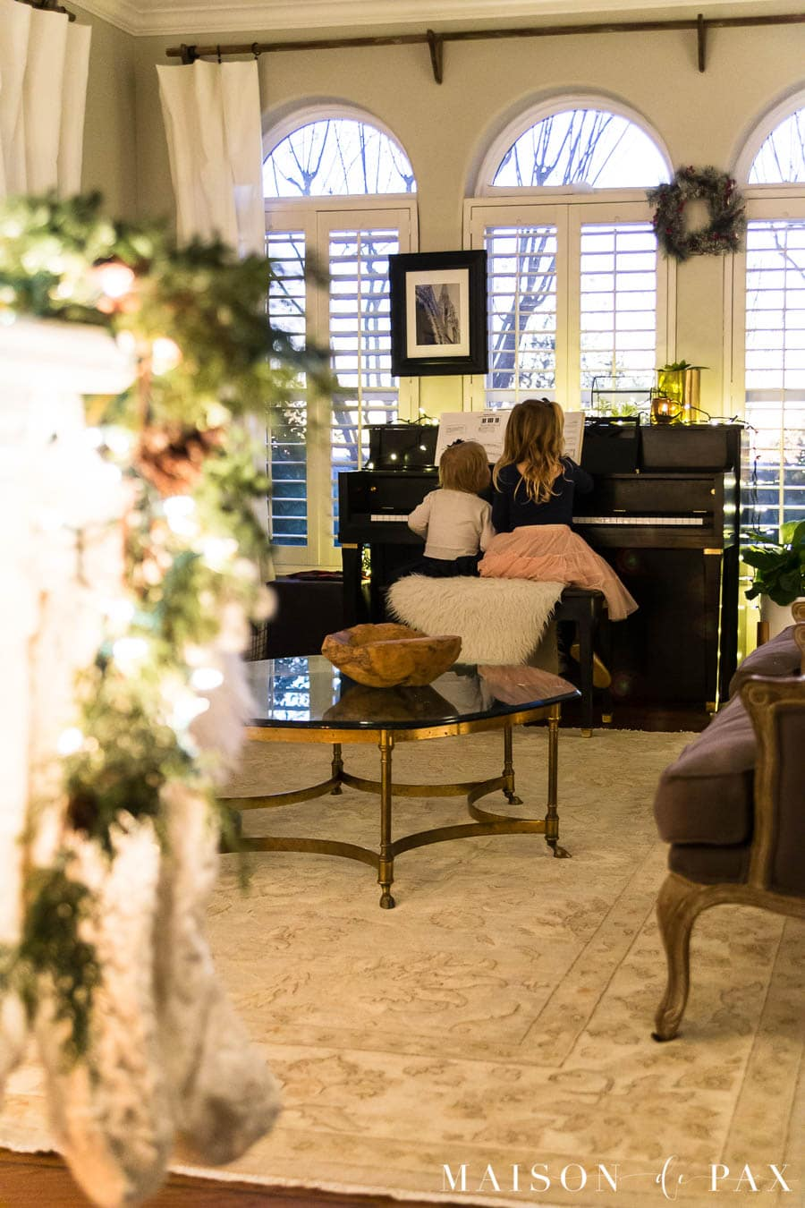 girls playing piano at Christmas time | Maison de Pax