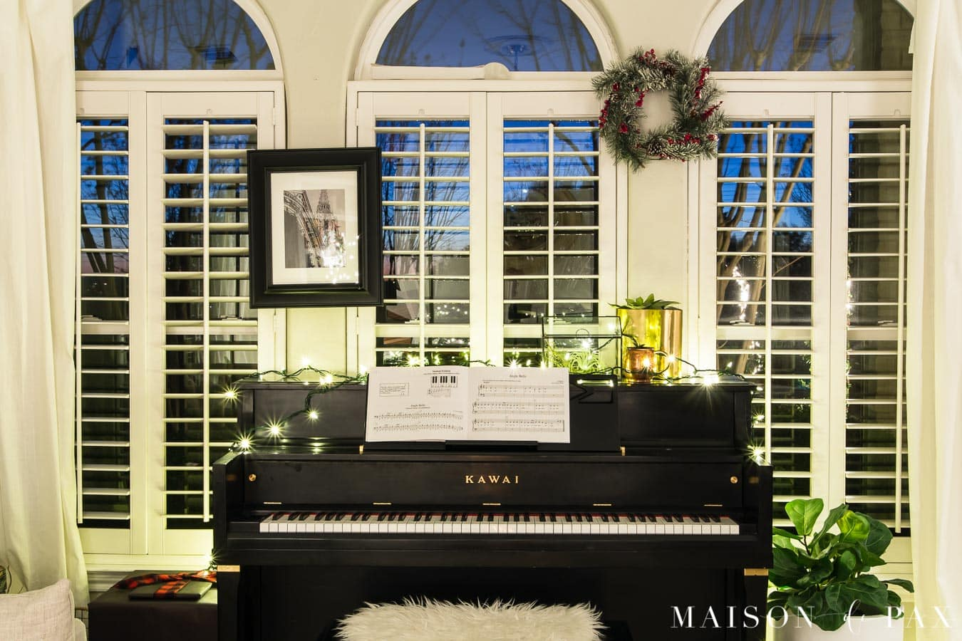 piano with string of Christmas lights | Maison de Pax