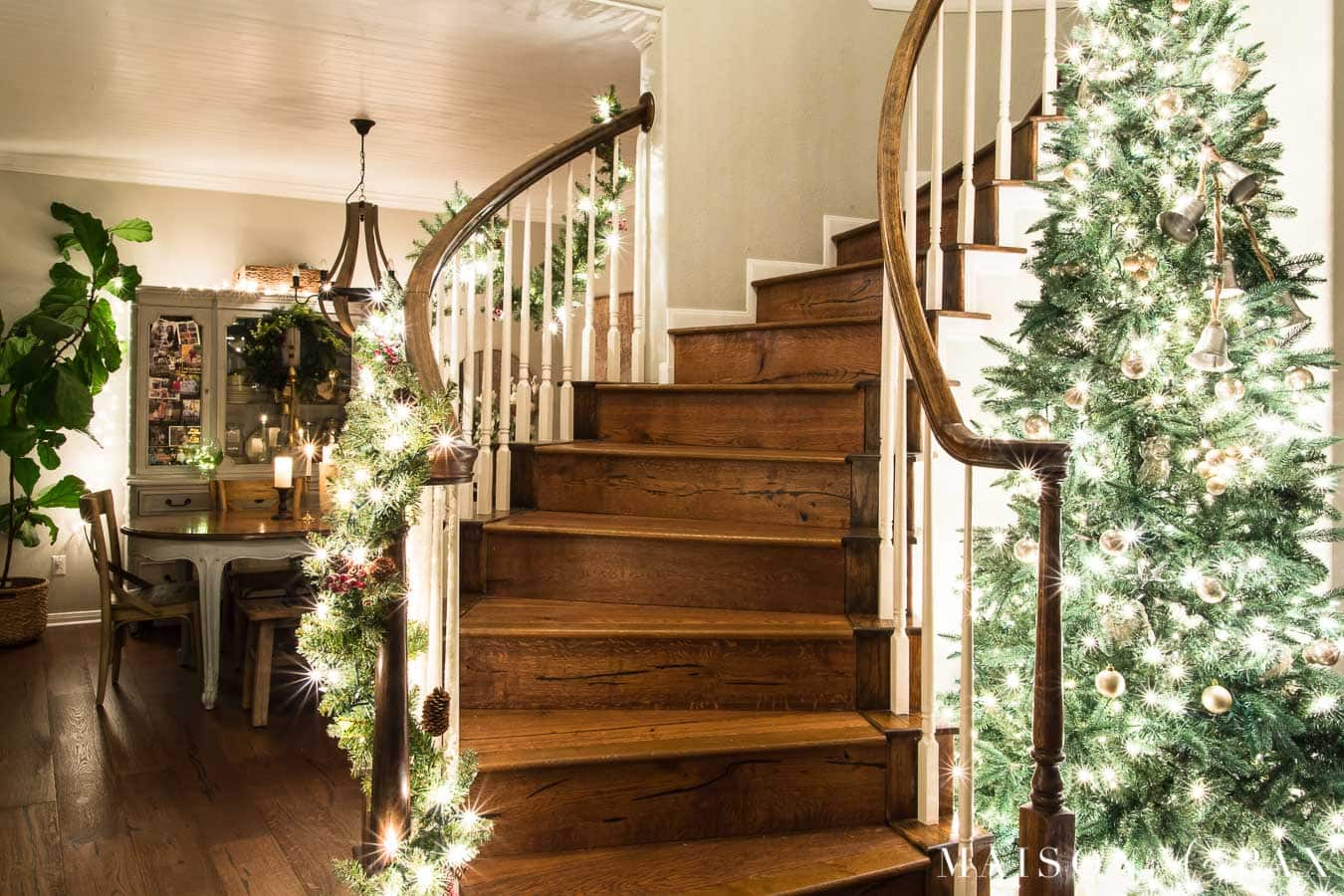 large christmas tree in curved stairwell | Maison de Pax