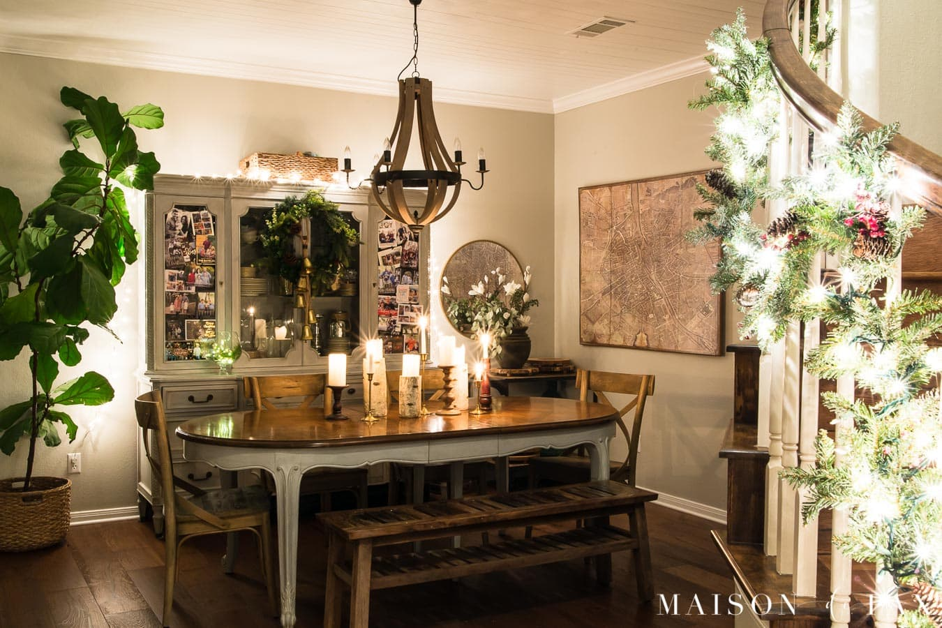 dining room lit by holiday lights | Maison de Pax