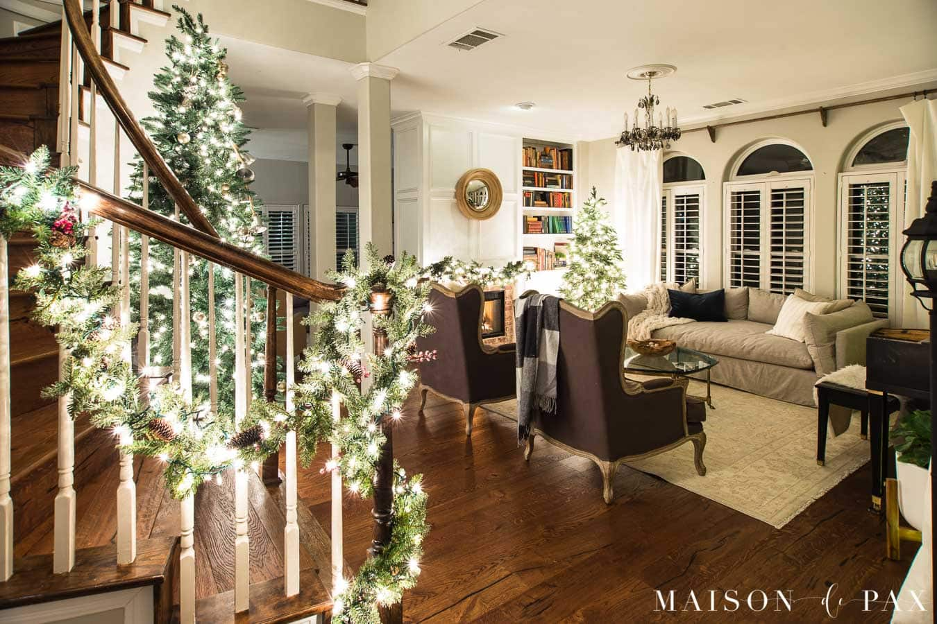 living room and stairwell lit by Christmas lights | Maison de Pax