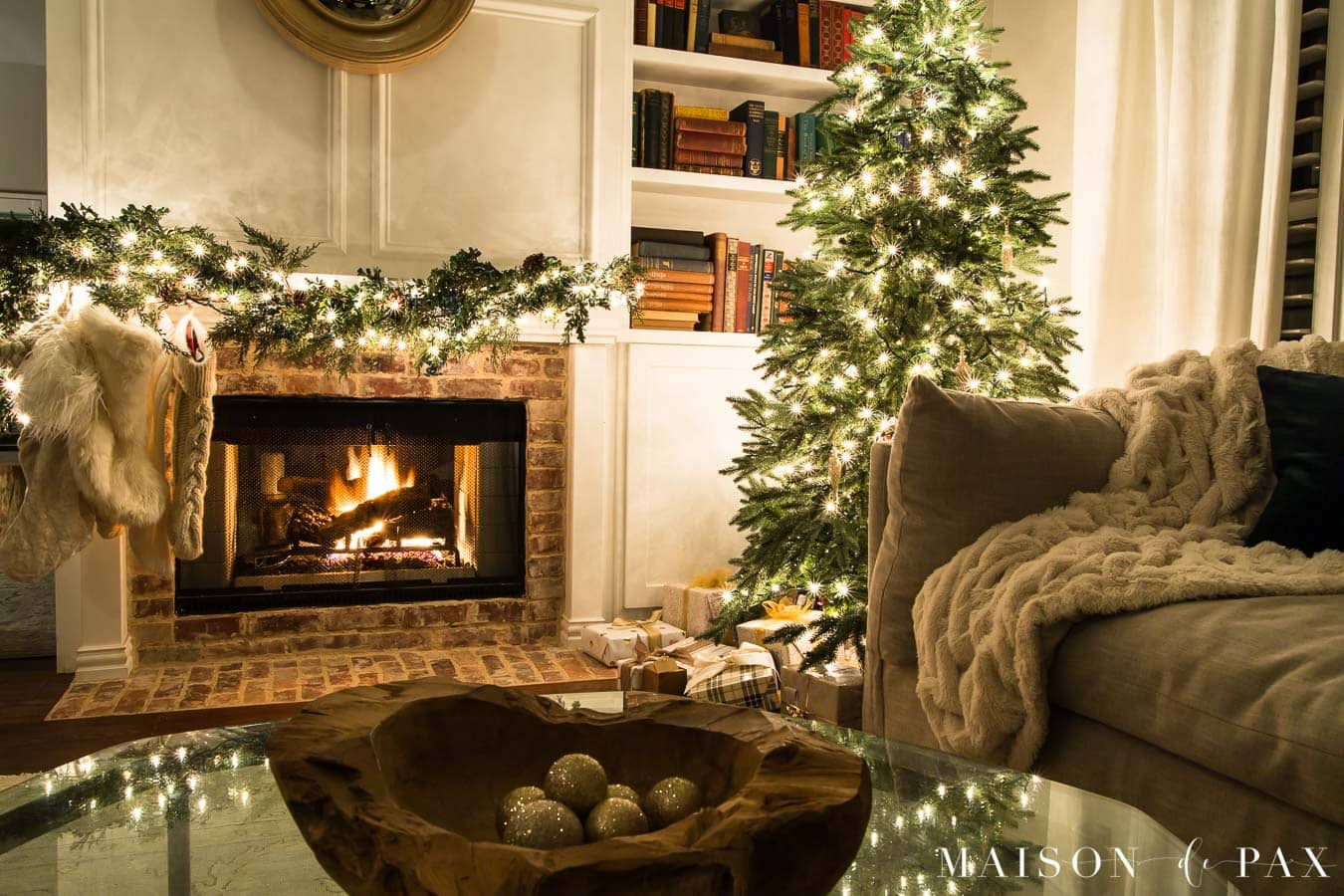 roaring fire and christmas lights | maison de pax