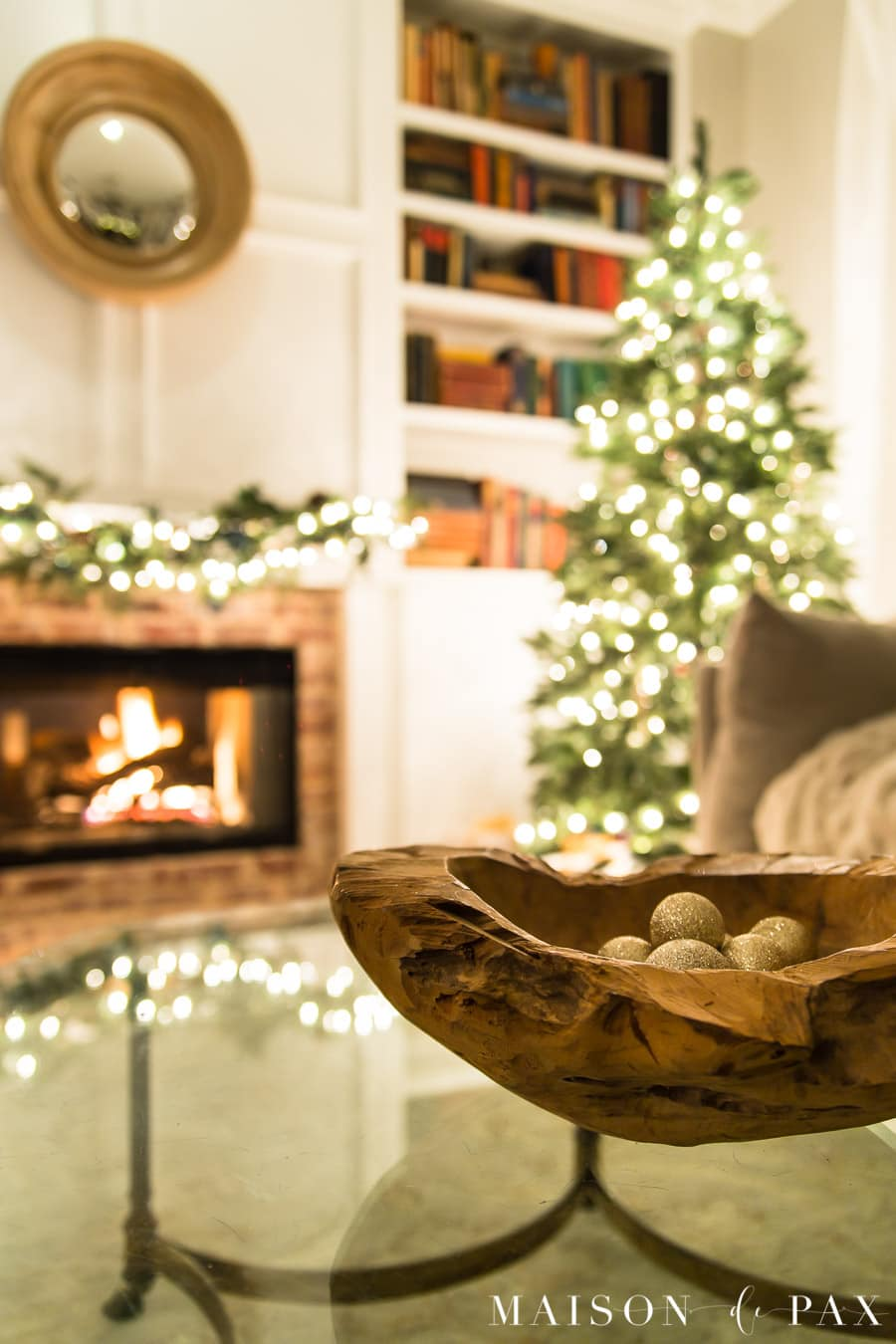 roaring fire in fireplace beside Christmas tree at night | Maison de Pax