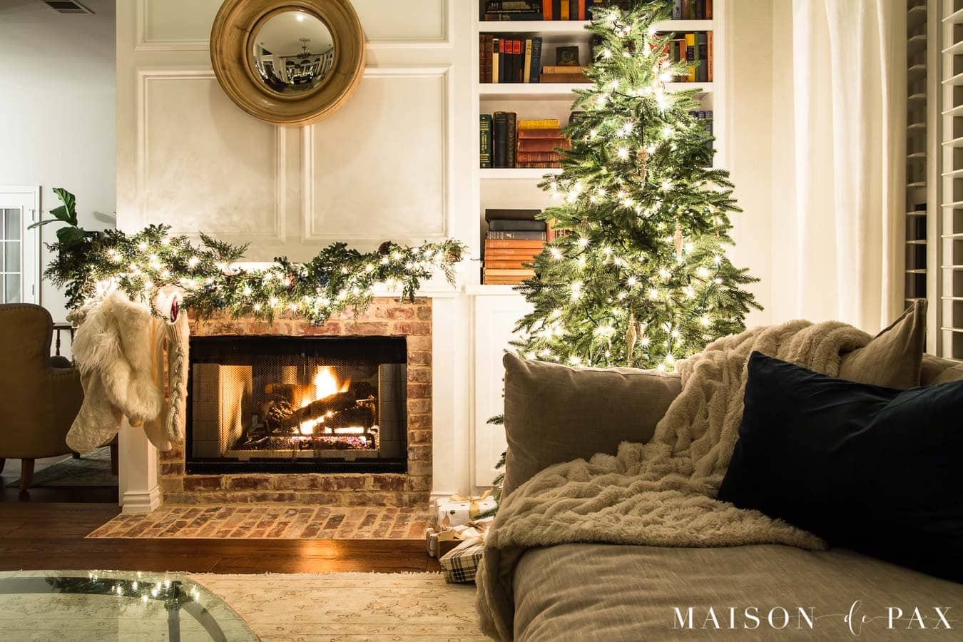 cozy couch beside christmas tree and fireplace | Maison de Pax