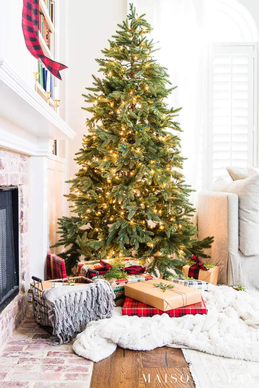 naked tree with simple brown paper and red plaid packages | Maison de Pax