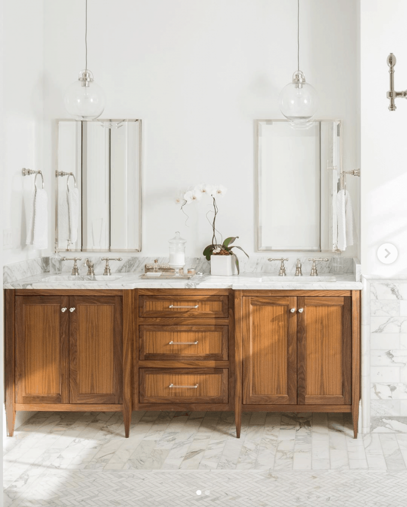 mcm wood vanity with marble countertop and tile