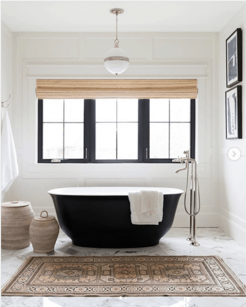 marble floor tile with black freestanding tub