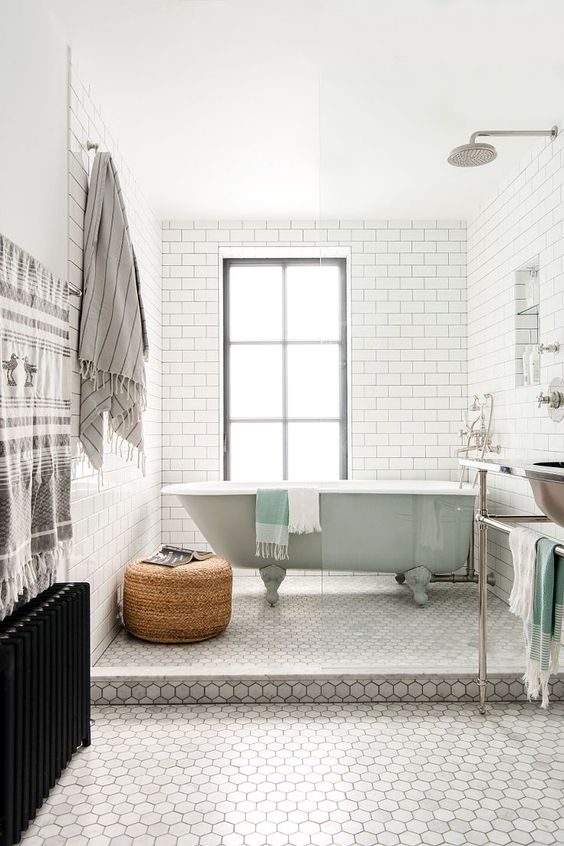 marble hex flooring with white subway tile walls