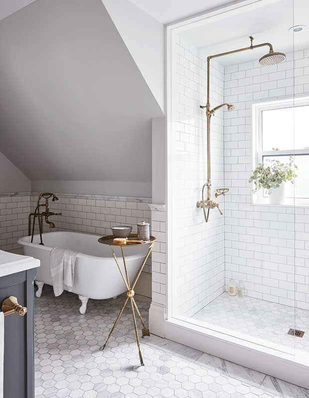 marble hex floors and white clawfoot tub in bathroom