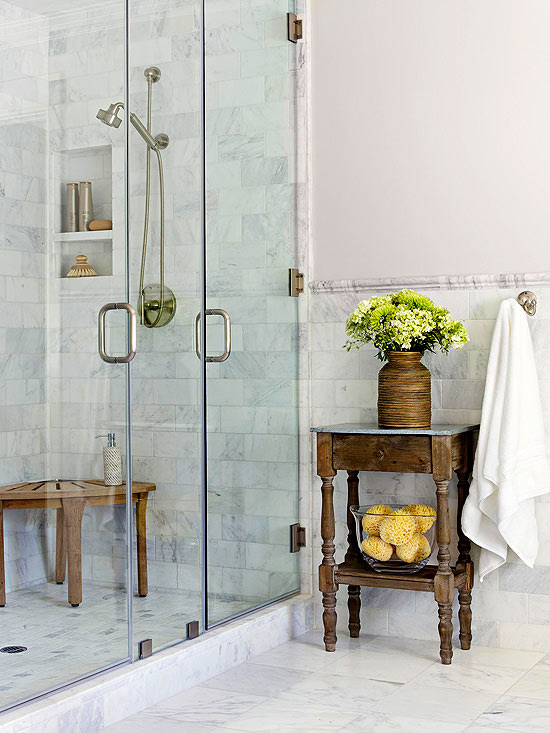 antique wood table beside marble shower