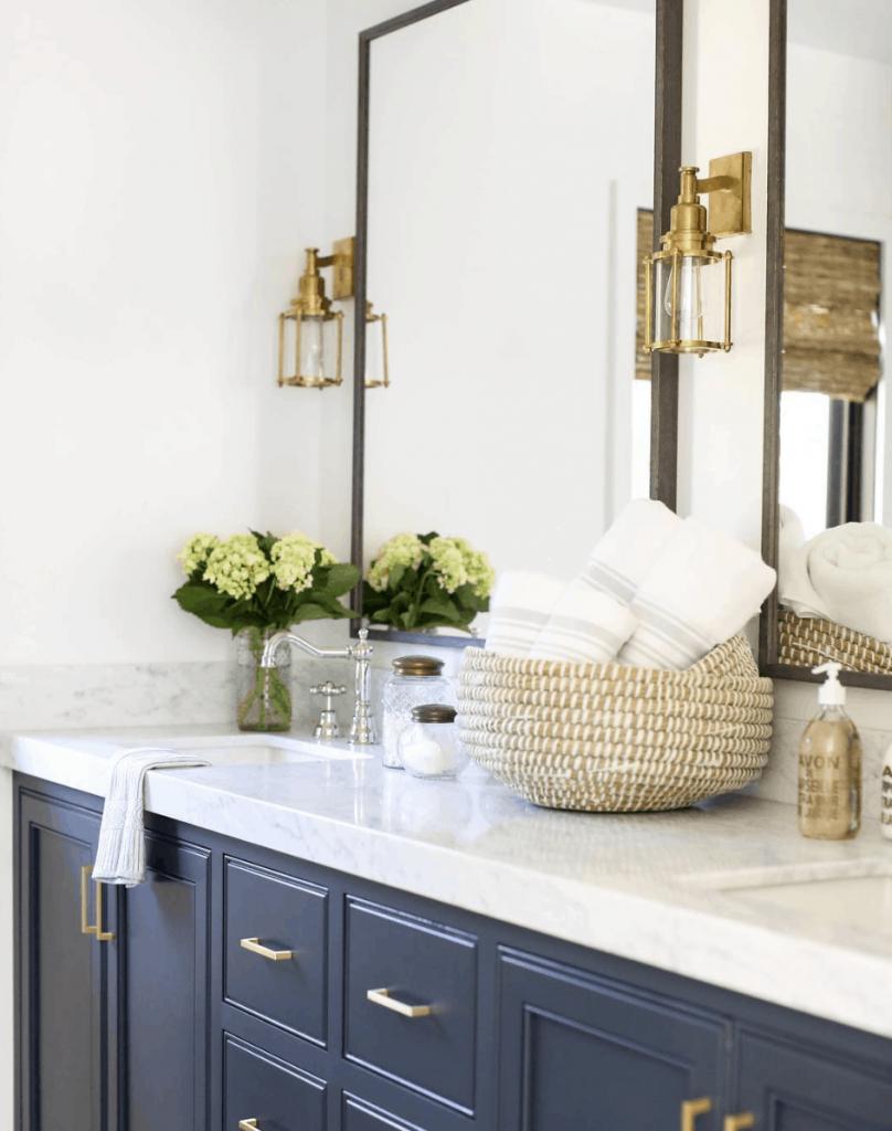 navy vanity with marble countertops