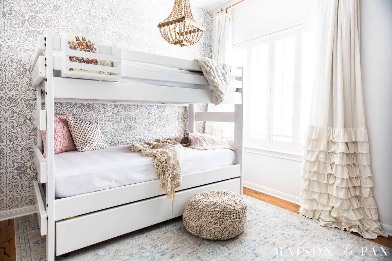 girl's room with white bunk bed, stenciled wall, ruffled curtians | Maison de Pax