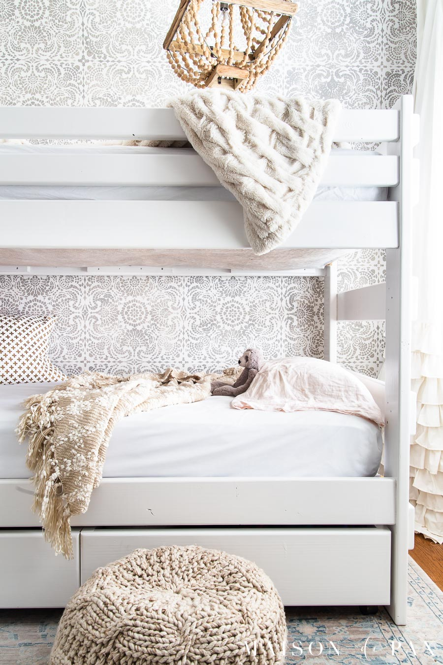 white bunk bed in front of gray and white stenciled wall | Maison de Pax