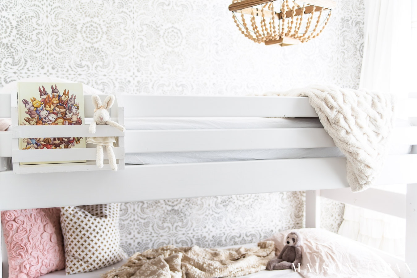 white bunk bed with neutral and pink accents | Maison de Pax